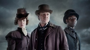 This image is embargoed until 00.01 Tuesday 3rd November 2015  From Rainmark Films  The Frankenstein Chronicles on ITV Encore  Pictured: Mary Shelley [Anna Maxwell Martin], John Marlott [Sean Bean] and Nightingale [Richie Campbell].  In the drama's opening sequences, the Home Secretary Sir Robert Peel, following a successful operation by Thames River Police to apprehend a gang of opium smugglers, recruits Marlott.    As he stands on the water's edge contemplating the arrest of the smugglers, Marlott makes a shocking discovery.  The body of a dead child is washed up on the shore and on further examination of the corpse he is horrified to discover it's not actually a child but rather a crude assembly of body parts arranged in a grotesque parody of a human form.  The mutilated child-like body leaves an indelible impression on Marlott and he finds himself unable to shake off the memory of what has happened that fateful night.  This photograph is (C) ITV Plc and can only be reproduced for editorial purposes directly in connection with the programme or event mentioned above, or ITV plc. Once made available by ITV plc Picture Desk, this photograph can be reproduced once only up until the transmission [TX] date and no reproduction fee will be charged. Any subsequent usage may incur a fee. This photograph must not be manipulated [excluding basic cropping] in a manner which alters the visual appearance of the person photographed deemed detrimental or inappropriate by ITV plc Picture Desk.  This photograph must not be syndicated to any other company, publication or website, or permanently archived, without the express written permission of ITV Plc Picture Desk. Full Terms and conditions are available on the website www.itvpictures.com  For further information please contact: james.hilder@itv.com / 0207 157 3052