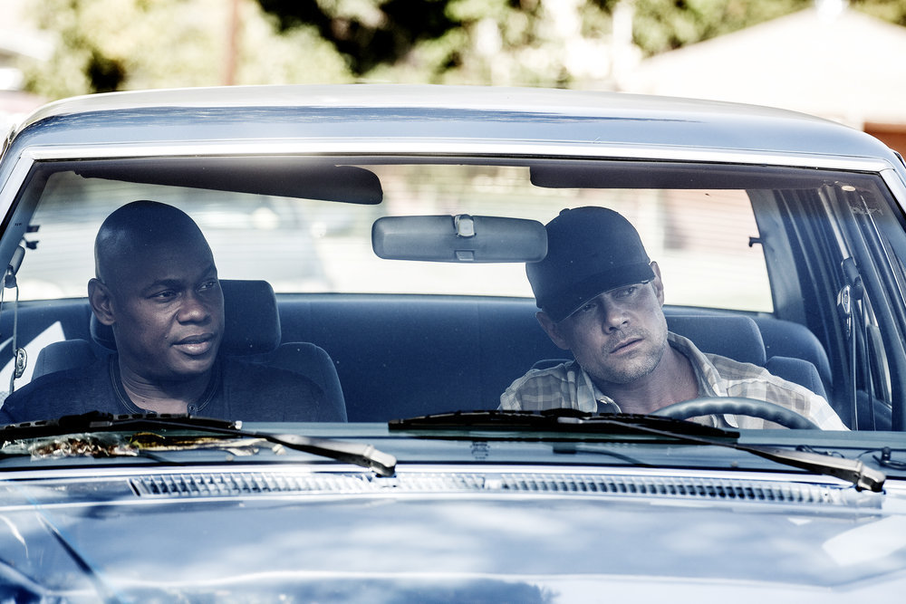 UNSOLVED: THE MURDERS OF TUPAC AND THE NOTORIOUS B.I.G. -- Episode 104 -- Pictured: (l-r) Bokeem Woodbine as Officer In Charge Daryn Dupree, Josh Duhamel as Detective Greg Kading -- (Photo by: Isabella Vosmikova/USA Network)