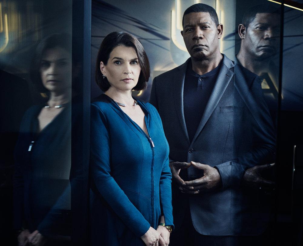 INCORPORATED -- Season:1 -- Pictured: (l-r) Julia Ormond as Elizabeth Krauss, Dennis Haysbert as Julian -- (Photo by: Gavin Bond/Syfy)