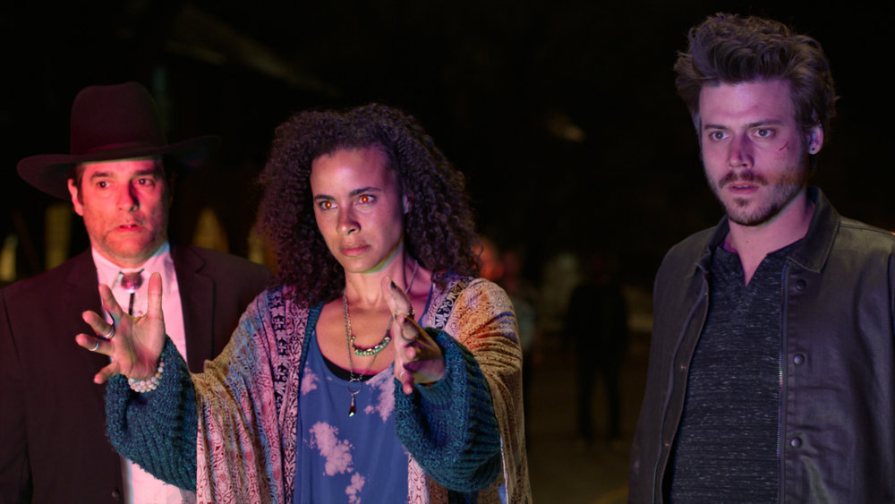 "MIDNIGHT TEXAS -- ""Pilot"" -- Pictured: (l-r) Yul Vázquez as Rev. Emilio Sheehan, Parisa Fitz-Henley as Fiji, Francois Arnaud as Manfred -- (Photo by: NBC)"