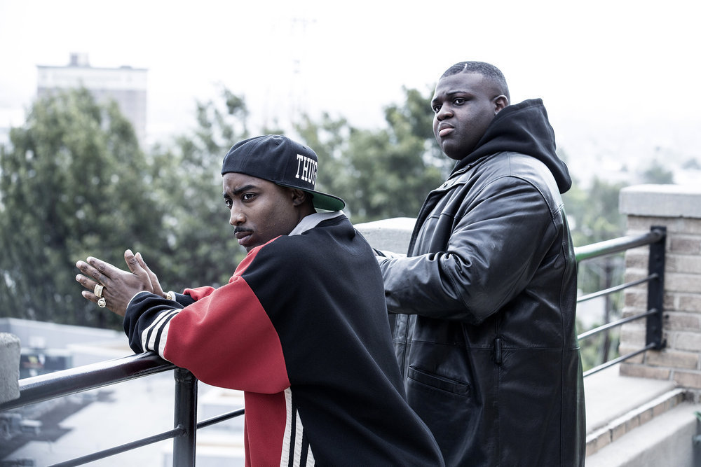 "UNSOLVED -- Episode 103 -- Pictured: (l-r) Marcc Rose as Tupac Shakur, Wavyy Jonez as Christopher ""Biggie"" Wallace -- (Photo by: Isabella Vosmikova/USA Network)"